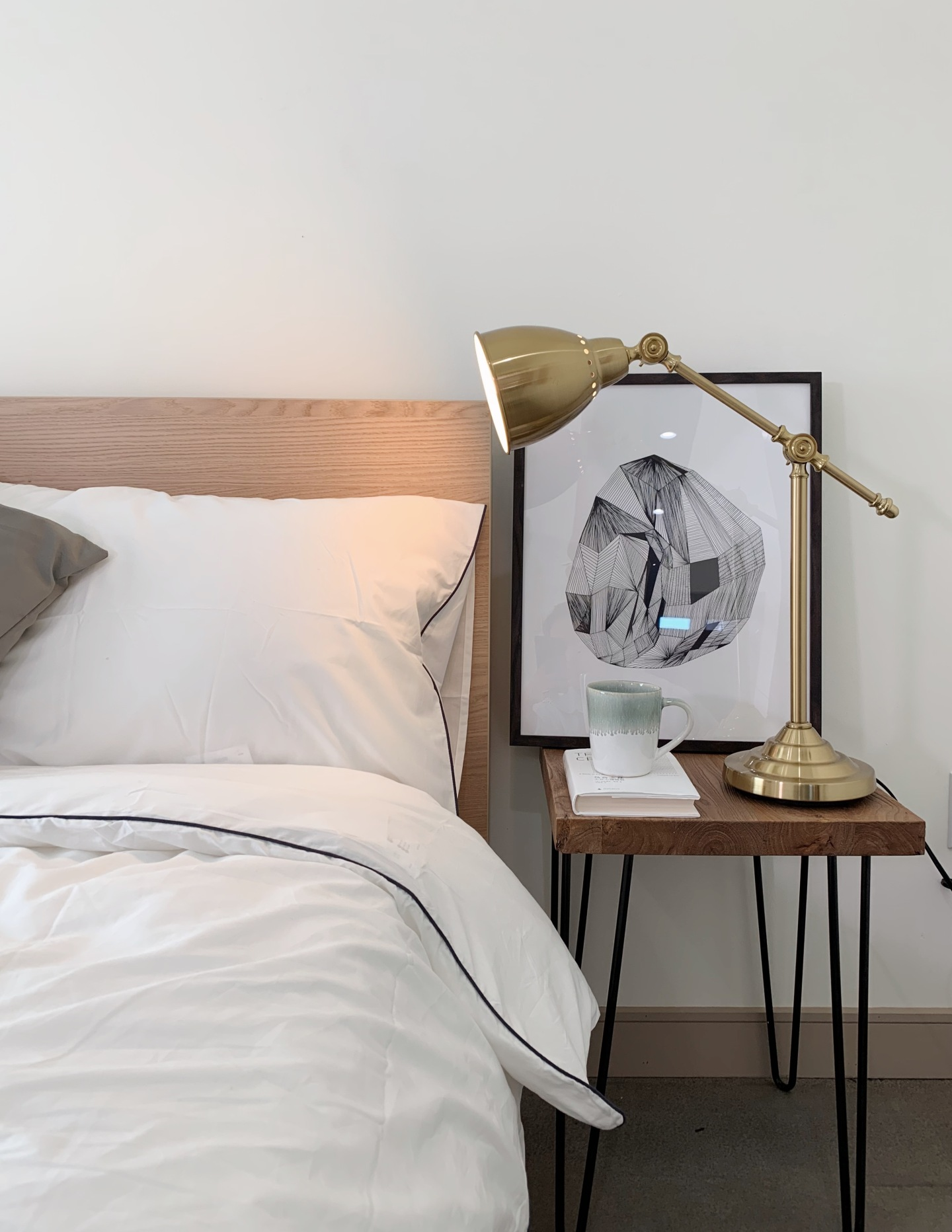 wood bed frame with gold lamp