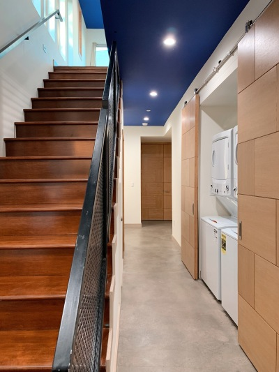 Brown staircase, long hallway