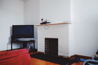 white fireplace, brown wood panels
