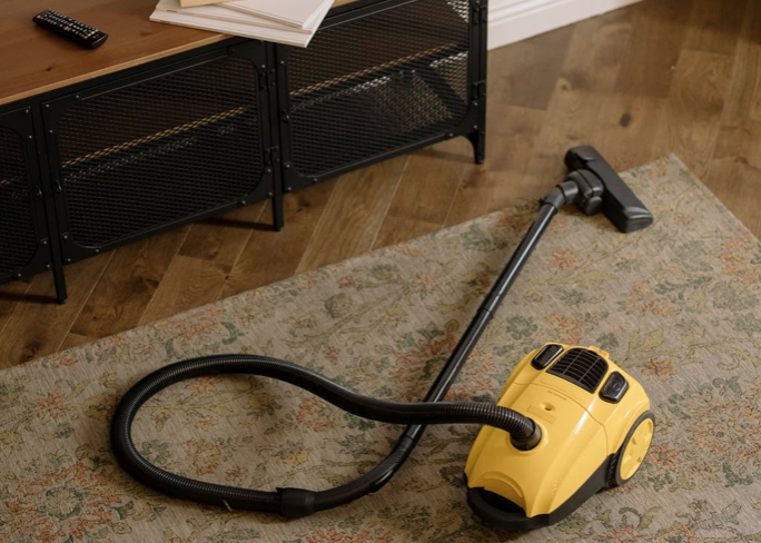 Yellow vacuum to clean students apartment