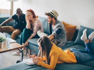 4 co-living roommates hanging out in common area