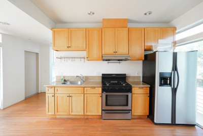 Kitchen, Brown hardwood floors with brown cabinets