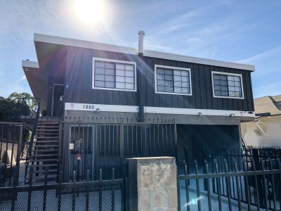 Tripalink Property, grey two floor houses with big windows near USC campus,
