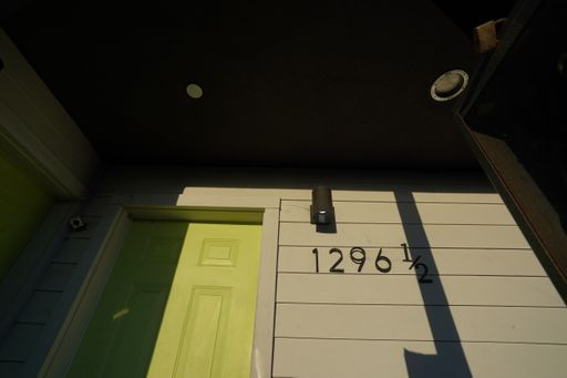 New, Tripalink Property, white USC student housing apartment, exterior with big windows