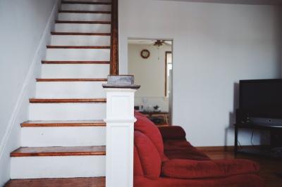 white and reddish brown stairs
