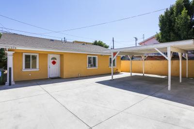 Yellow exterior, 1374 W.35th Pl, White Garage