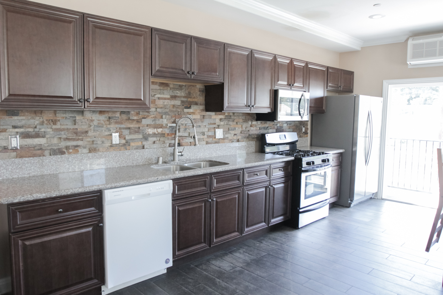 Large Kitchen, Dark wood Cabintry, silver stove
