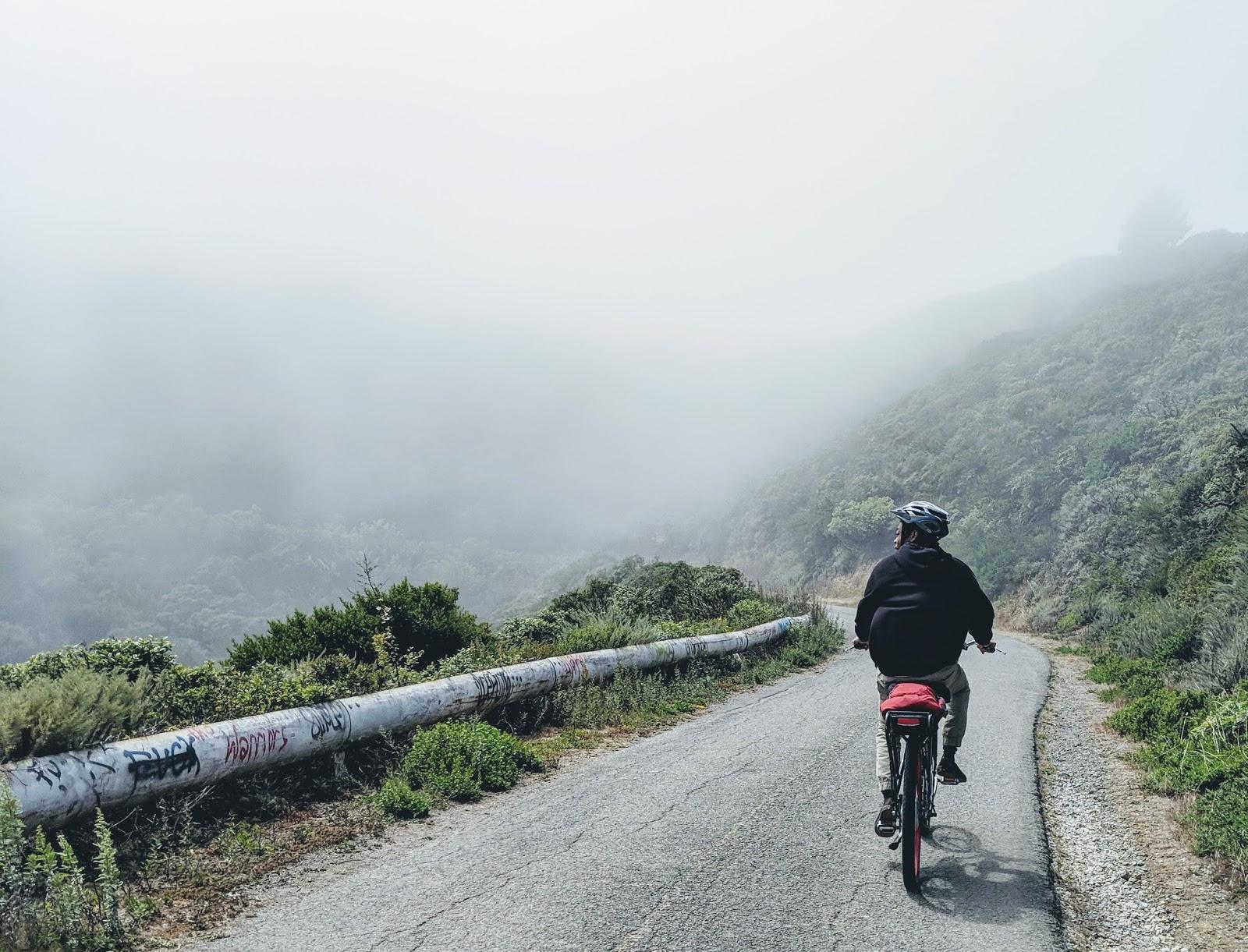 someone biking on a mountain trail
