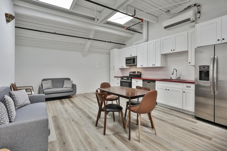 White Kitchen, Grey Sofas