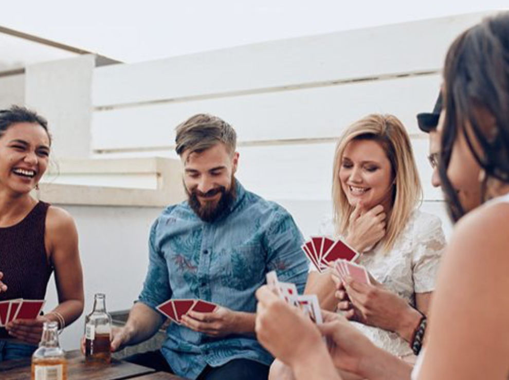 A group of people playing a card game