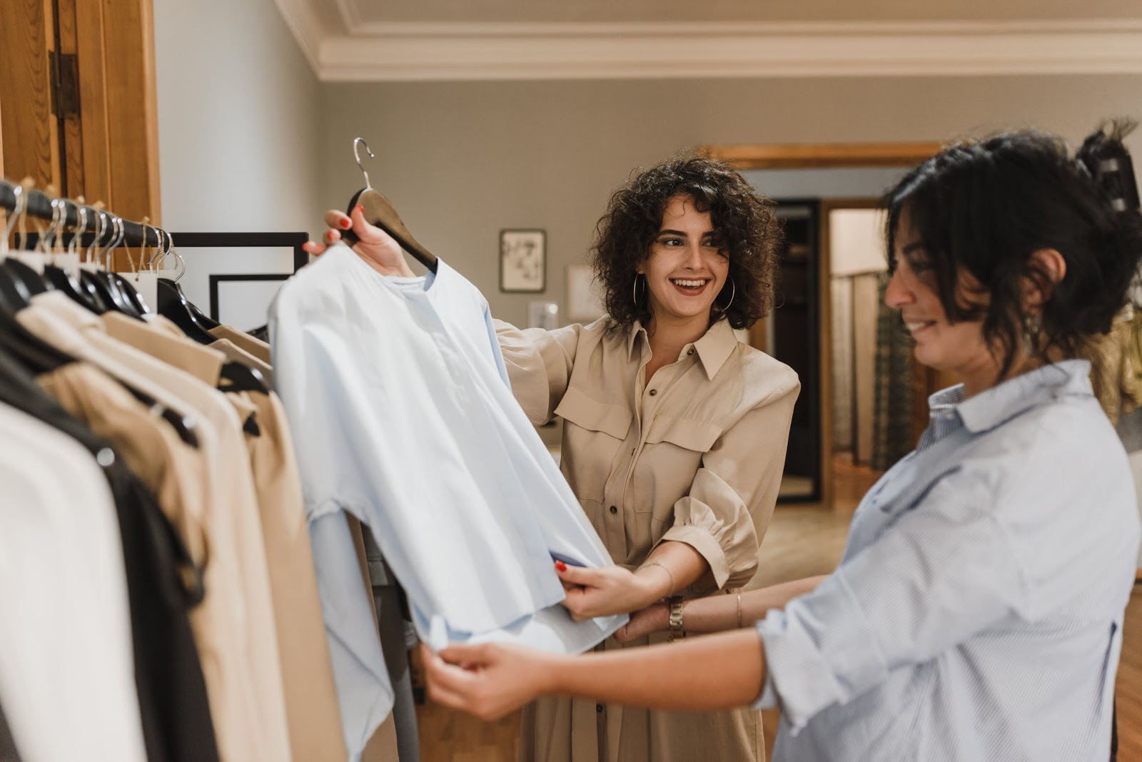 two women in a store looking at a shirt