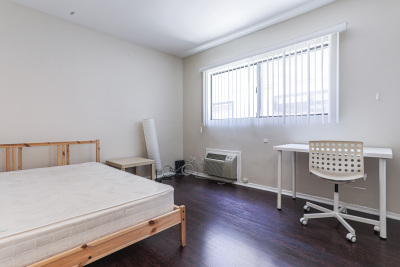 Tripalink Property. bright bedroom furnished with desk and bed, USC student housing