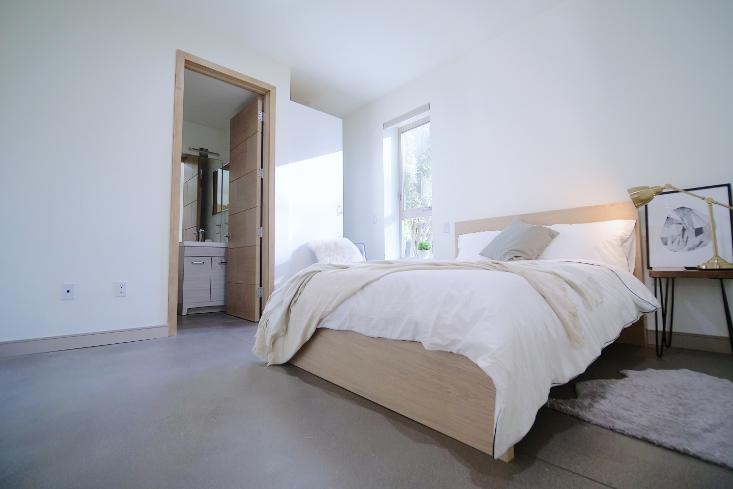 bright bedroom with white fluffy bed