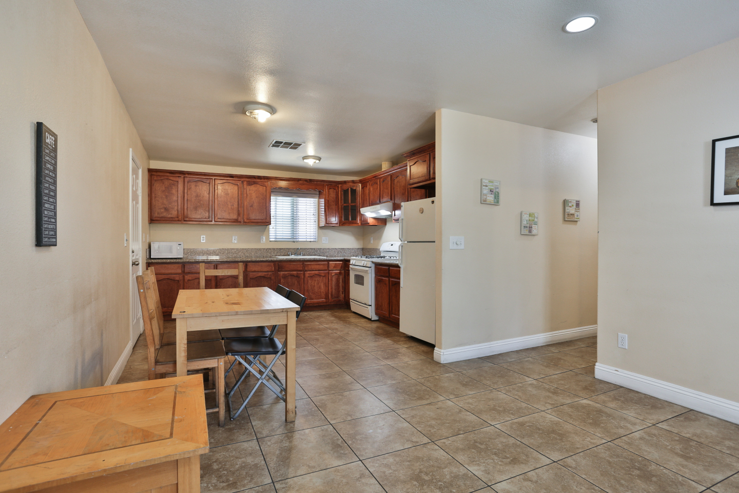 huge kitchen and dining area, granite floors, brown Cabinets