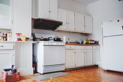 Large white kitchen, wood countertop