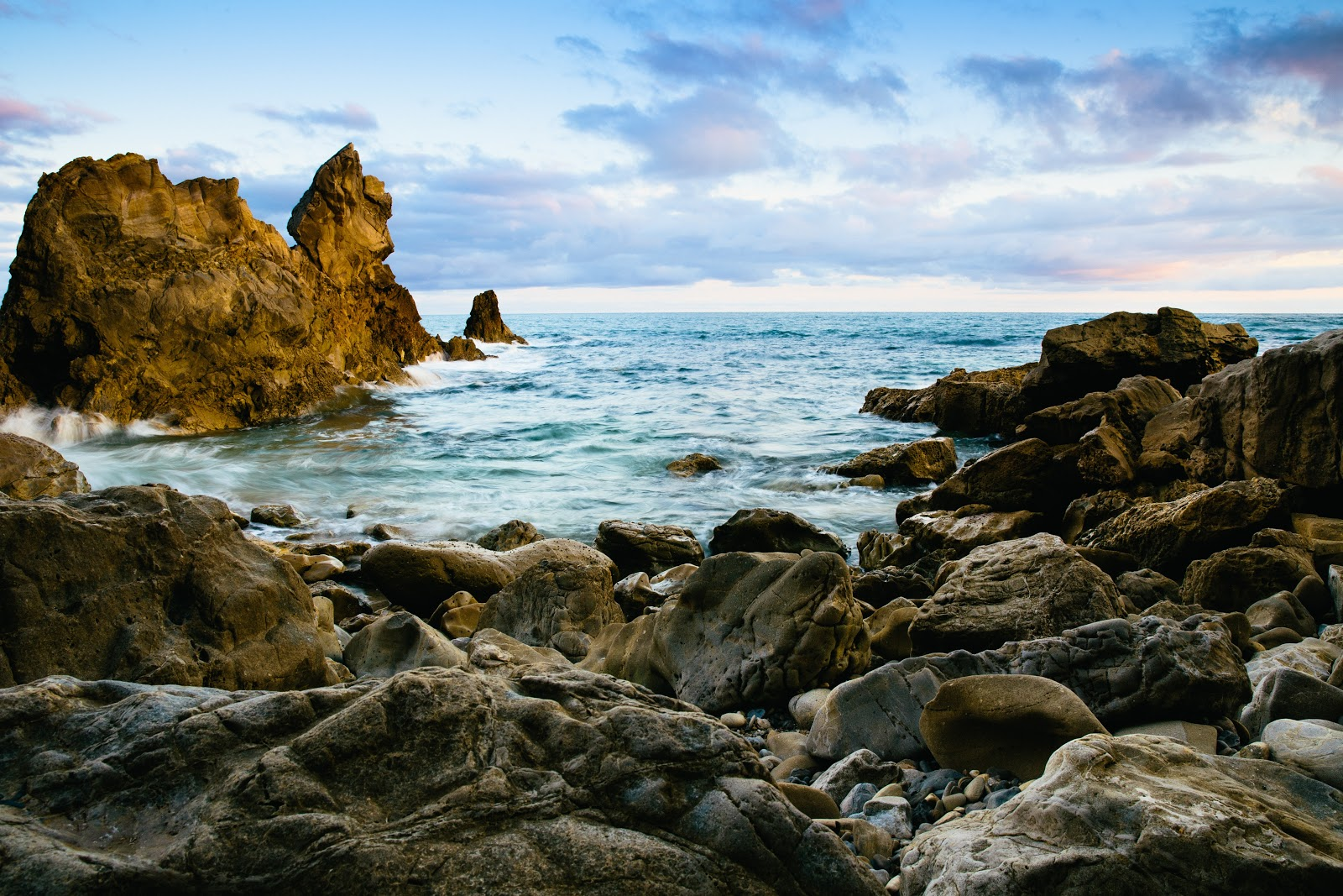 beautiful view of rocks and water on Little Corona Del Mar