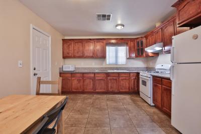 Kitchen, dark brown cabinets and granite floors
