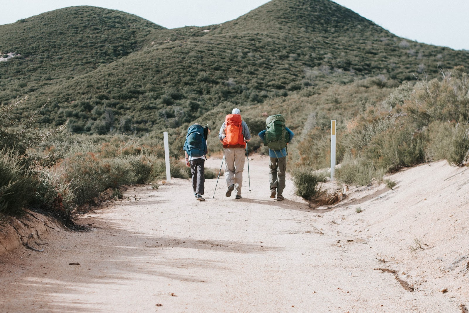 3 people hiking on a trail in Irvine