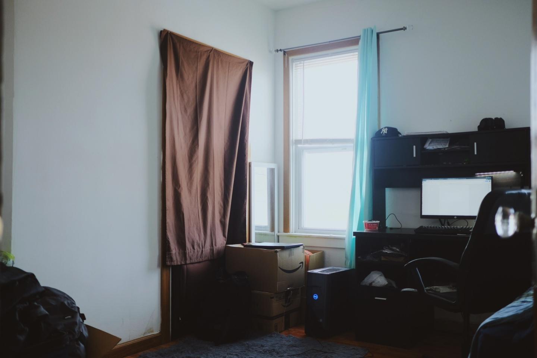 brown sheet covering doorway, bedroom