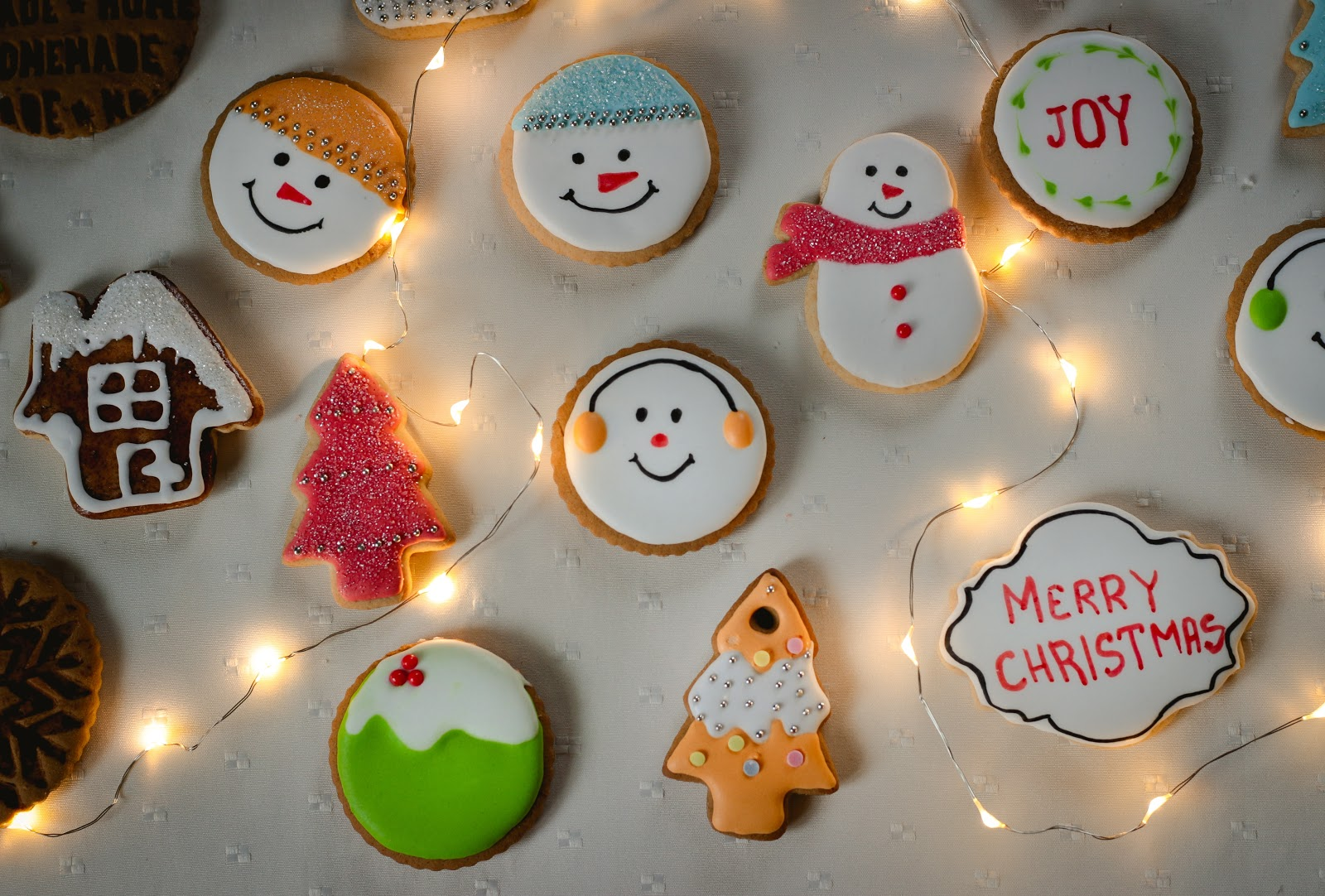 an assortment of decorated Christmas cookies