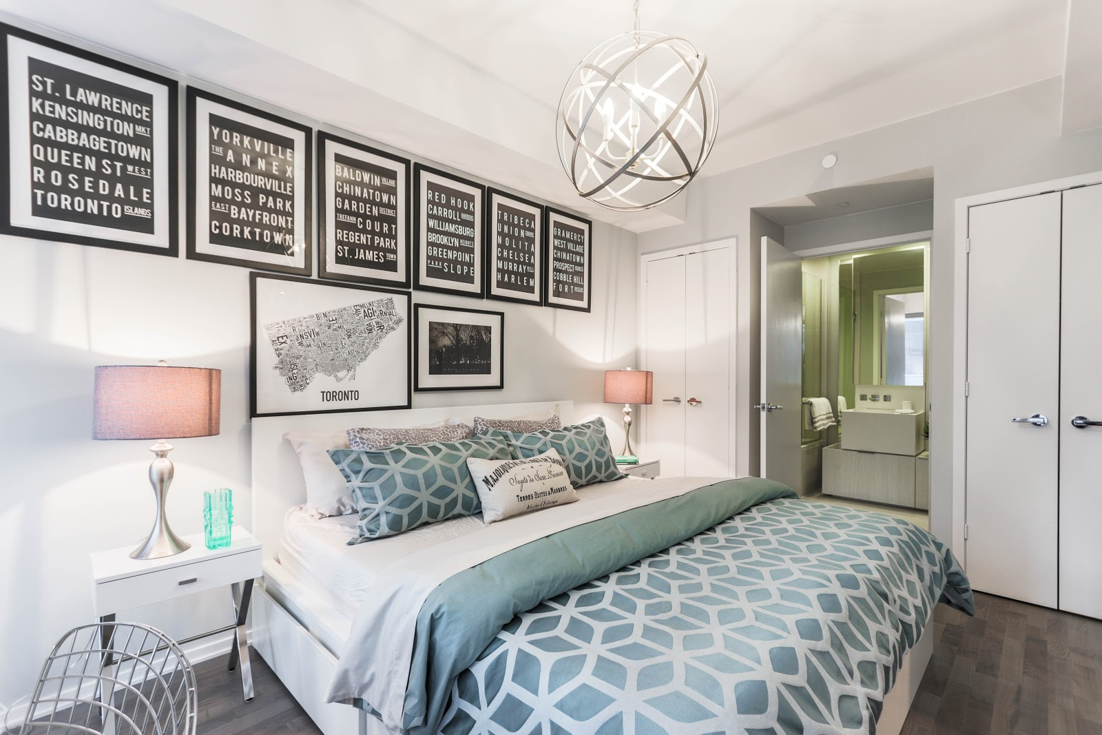 beautifully decorated bedroom with multiple pieces of wall art