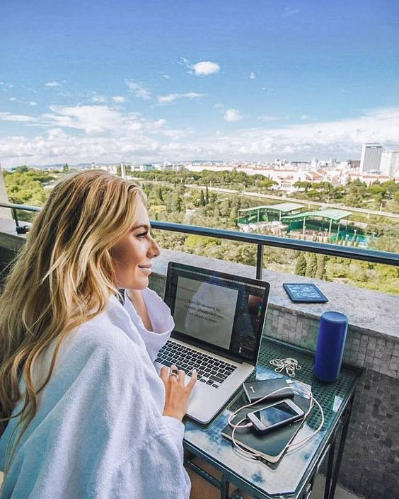 co living for digital nomads,  Blonde woman wit =h open Macbook