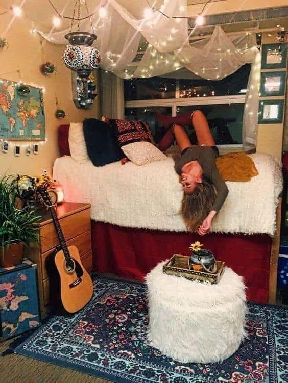 girl lying across bed in personal room