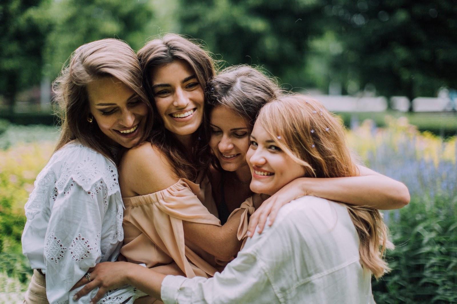Four women hugging . co-living roommates