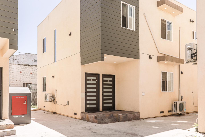 Tripalink 1176 W 24th St Property, cream exterior