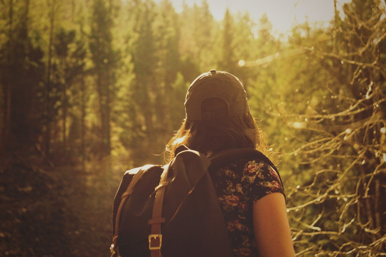 beautiful photo of woman on hiking journey from back angle