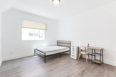 large bedroom with hardwood floor
